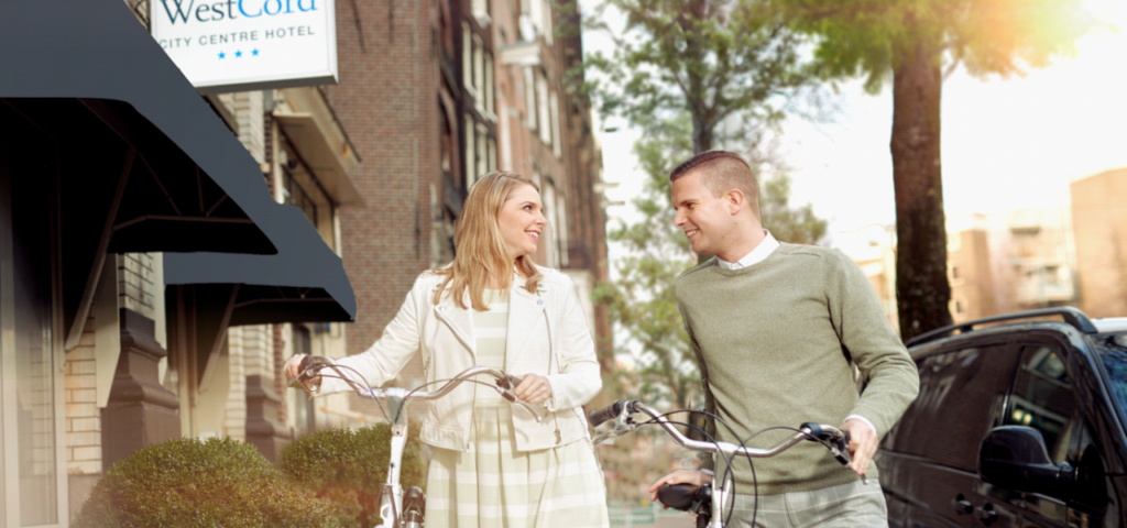 Couple with Bikes WestCord City Centre Hotel Amsterdam - Westcord Hotels