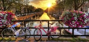 Fietsen over de grachten van Amsterdam - Westcord Hotels